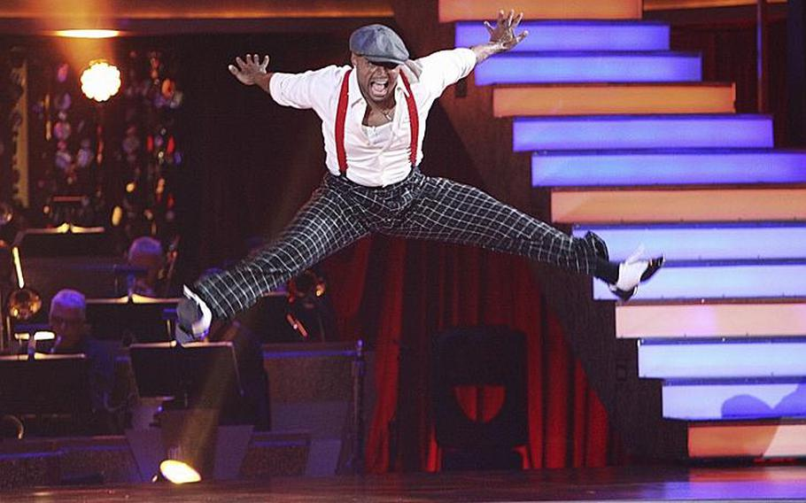"""J.R. Martinez leaps during his jive on the second week of """"Dancing with the Stars."""""""