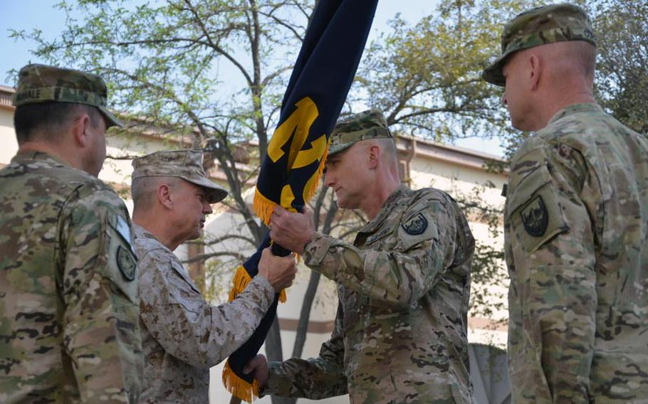 The International Security Assistance Force and US Forces-AfghanistanCommander, U.S. Marine Corps Gen. John R. Allen, second from left, transfers the colors from outgoing USFOR-A Deputy Commander-Support Army Maj. Gen. Timothy P. McHale, left, to incoming USFOR-A Deputy Commander-Support Army Maj. Gen. William E. Rapp during a Friday ceremony at the New Kabul Compound, Afghanistan.  At right is USFOR-A Command Sgt. Major Ronnie D. Curry.