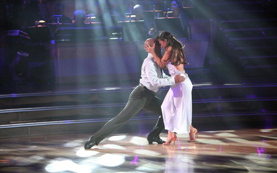 """On this week's """"Dancing with the Stars,"""" themed """"The Most Memorable Year of My Life,"""" each couple performed a Ballroom or Latin style of dance to their song of choice. J.R. Martinez, right, and his parter Karina Smirnoff performed a rumba to """"If You're Reading This."""""""
