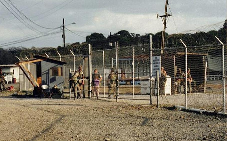 Soldiers gather at the gate of one of the four camps that the U.S. military built to house Cuban refugees in Panama in 1994. On Dec. 8, 1994, hundreds of refugees rioted, throwing thousands of rocks at U.S. soldiers who came inside to quell the disturbance.