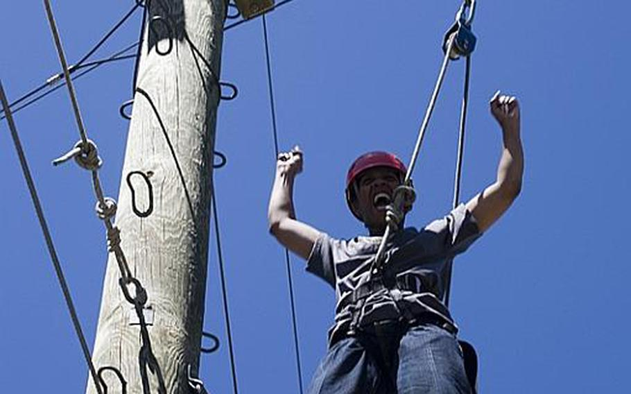 Veronica Smith of Milwaukee celebrates after climbing a ropes course at a Wounded Warrior Project, Project Odyssey retreat, in Park City, Utah, in July of 2009. Smith, who is dealing with PTSD and a TBI, joined a small group of injured service women at this all-woman Project Odyssey to help each other in their recovery process. Outdoor retreats with other veterans that feature counseling is just one of the many ways veterans have been seeking treatment for PTSD and TBI through alternative or integrative approaches in recent years. There have been mixed results but some of the treatments have been successful enough that the VA has begun to take notice and has started to build treatment plans using some of the methods.