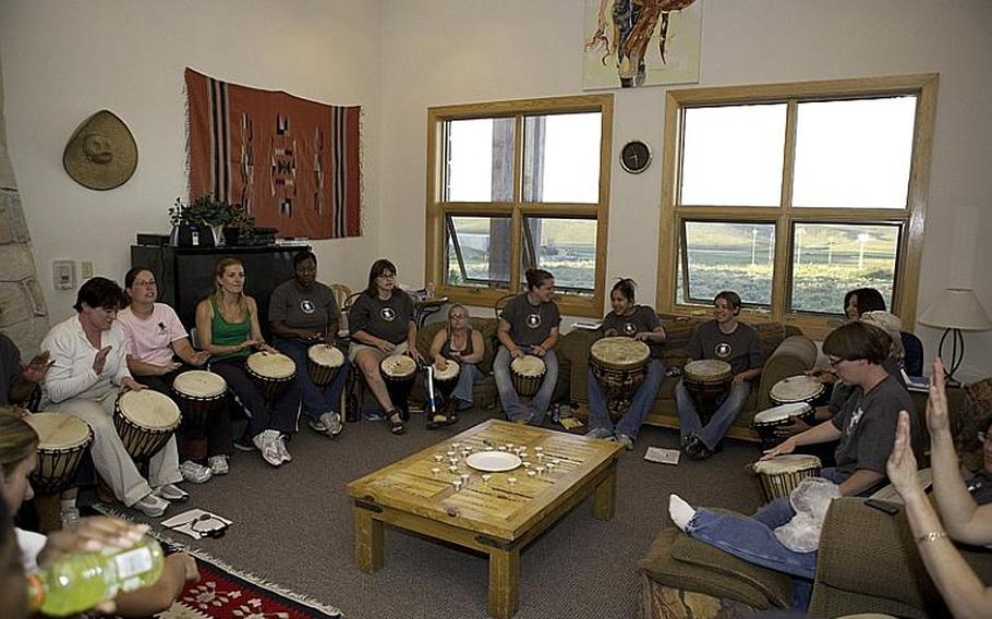 Wounded warriors bond during a drum circle at a WWP Project Odyssey retreat in Park City, Utah, in July 2009. The drum circle is one of the many different activities featured during the small-group retreat to help injured service men and women recover from PTSD.