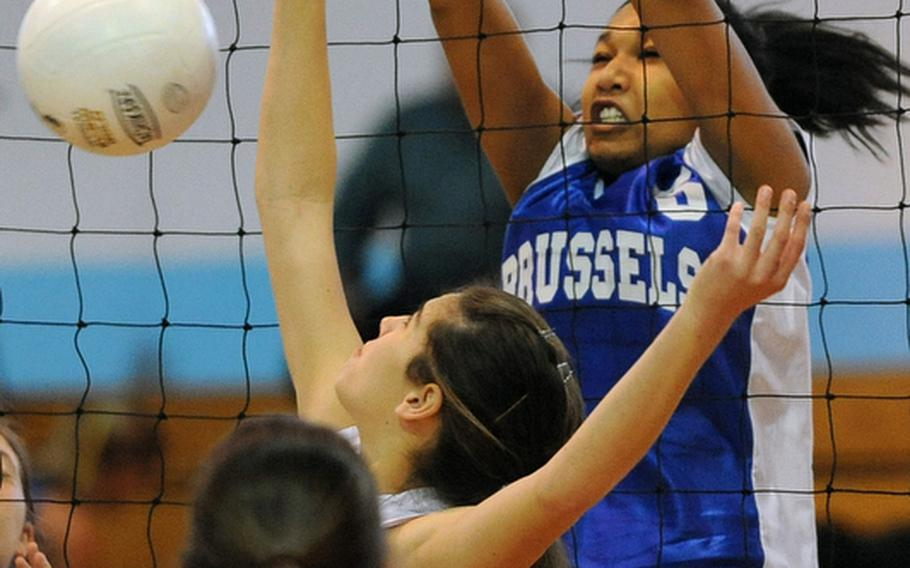 Anya Shelton of Brussels knocks back a shot by Emily Cotton of Lajes in their Division III match  at the DODDS-Europe volleyball championships. Brussels won the match 25-11, 25-5.