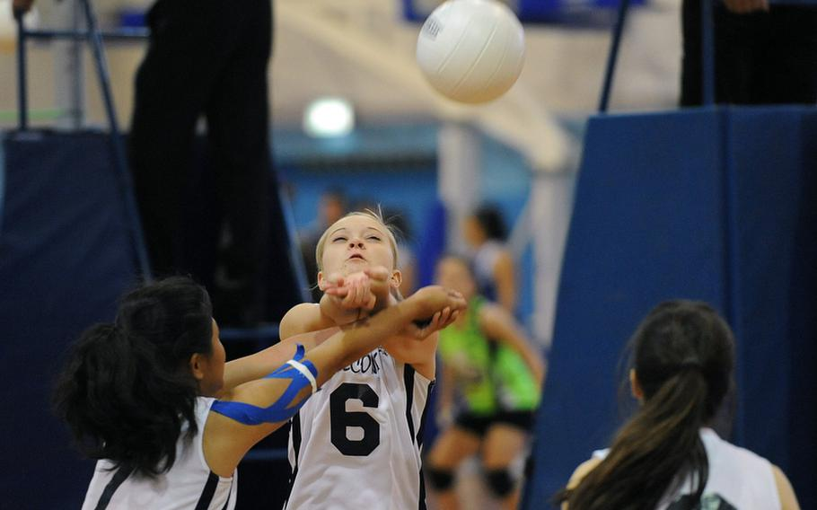 Heidi Dacayanan, left, and Caitlin Scott of Lajes return a ball in their Division III match against Brussels at the DODDS-Europe volleyball championships. Brussels won the match 25-11, 25-5.