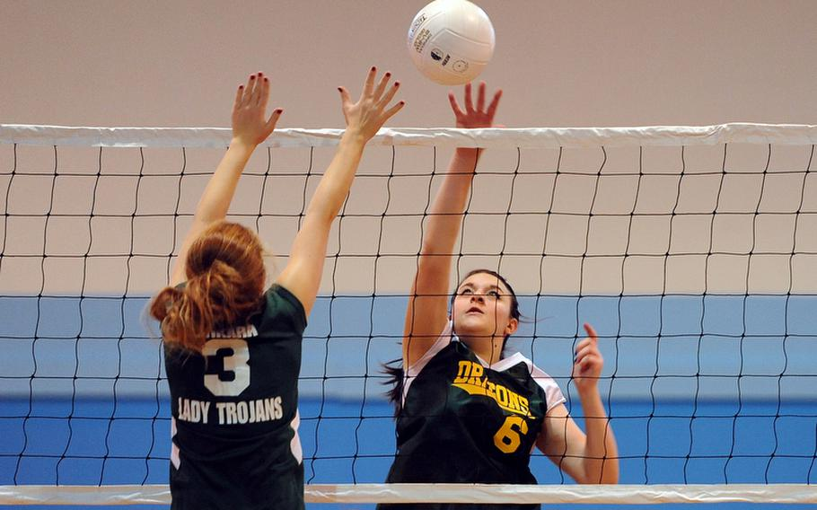 Alconbury's Hailey Sorensen knocks the ball over the net as Ankara's Aliz Soos defends in a Division III match at the DODDS-Europe volleyball championships. Alconbury won 25-15, 17-25, 25-17.