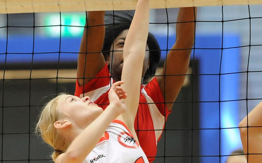 AOSR's Olivia Mansager, foreground, tries to get the ball past Schweinfurt's  Shadaja Gamble in a Division II match at the DODDS-Europe volleyball championships. The Falcons beat Schweinfurt 25-22, 30-28.