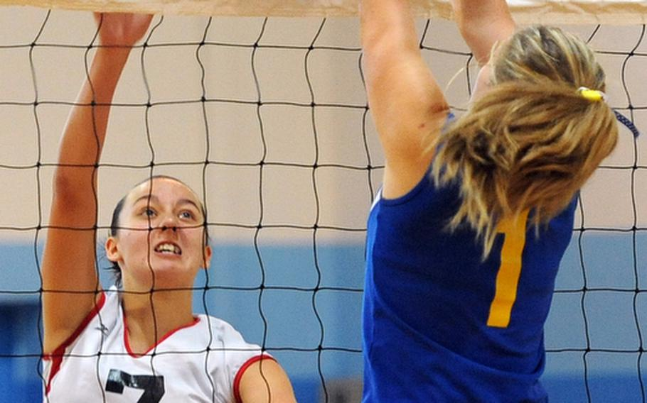 Menwith Hill's Kaia Pierce and Sigonella's Rachel Vosler battle at the net in a Division III match at the DODDS-Europe volleyball championships. Sigonella won 25-16,25-19.