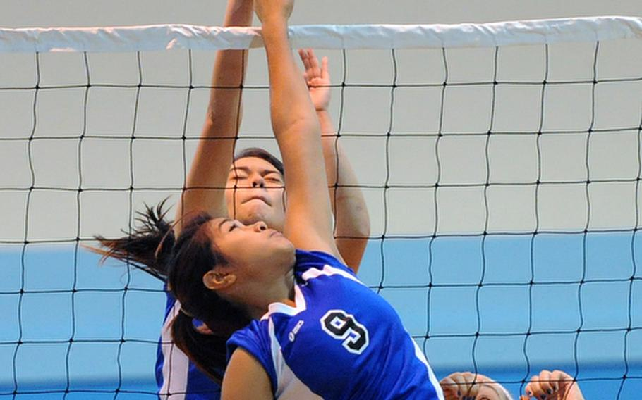 Incirlik's Alexis Cruz, foreground, and Rota's Mikaela Palmer fight at the net in a Division III match at the DODDS-Europe volleyball championships. Top-seeded Rota won 25-7, 25-7.