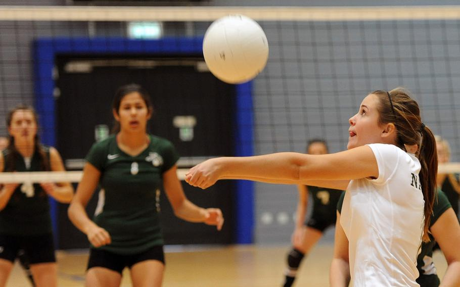 Valerie Cariello of Naples returns a ball in a Division II match at the DODDS-Europe volleyball championships. The Wildcats beat SHAPE 25-13, 25-13.