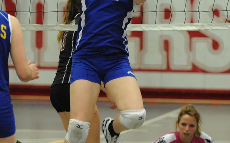Wiesbaden's Ellen Tafoya celebrates a point after hitting the ball unreachable for Vilseck's Amber Rose. Despite Tafoya's efforts the Falcons beat the Warriors 25-22, 22-25, 25-21 in a Division I match at the DODDS-Europe volleyball championships.