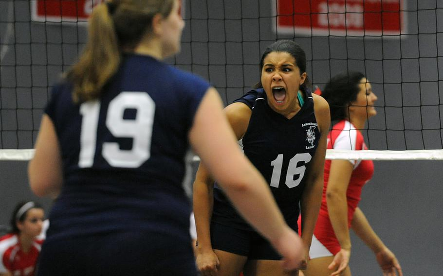 Lakenheath's Joudan Hodge celebrates a kill in  the Lancers' Division I match against Kaiserslautern at the DODDS-Europe volleyball championships. Kaiserslautern went on to win the match 25-22, 20, 25, 25-19.