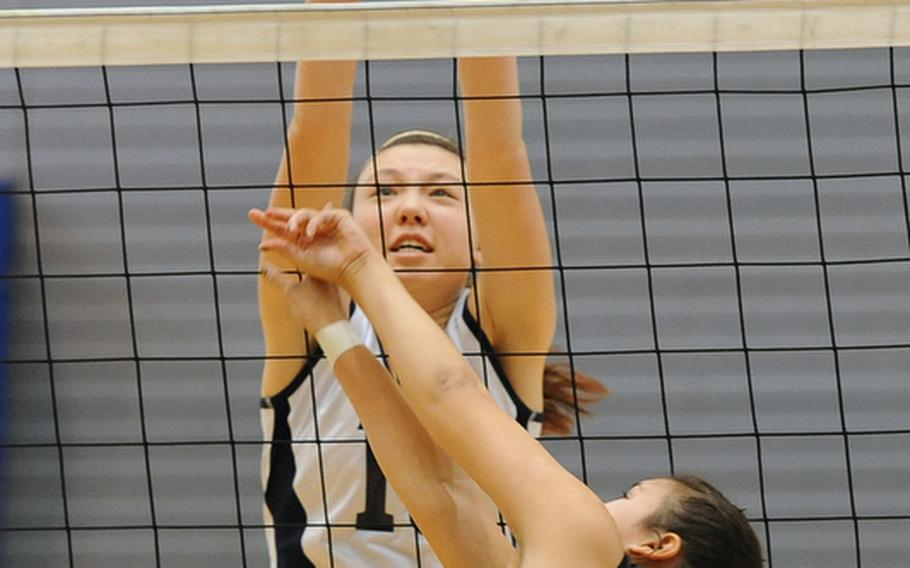 Bitburg's Michelle Morrison stretches as she tries to block a shot by Vicenza's Lorena Somera. Bitburg won the Division II match at the DODDS-Europe volleyball championships 25-23, 25-14.