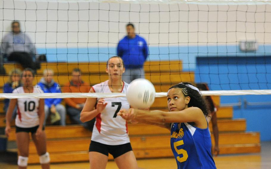 Sigonella's Deeanna Brown returns a Menwith Hill shot as the Mustangs' Kaia Pierce waits at the net. Sigonella won the Division III match at the DODDS-Europe volleyball championships 25-16, 25-19.