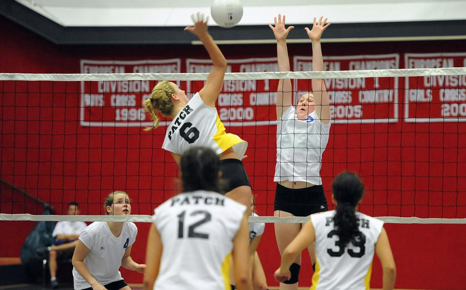 Patch's Rachel Hess tries to hit a ball past Ramstein's Sarah Schiller in A Division I match at the DODDS-Europe volleyball championships. Ramstein won 25-14, 25-12.