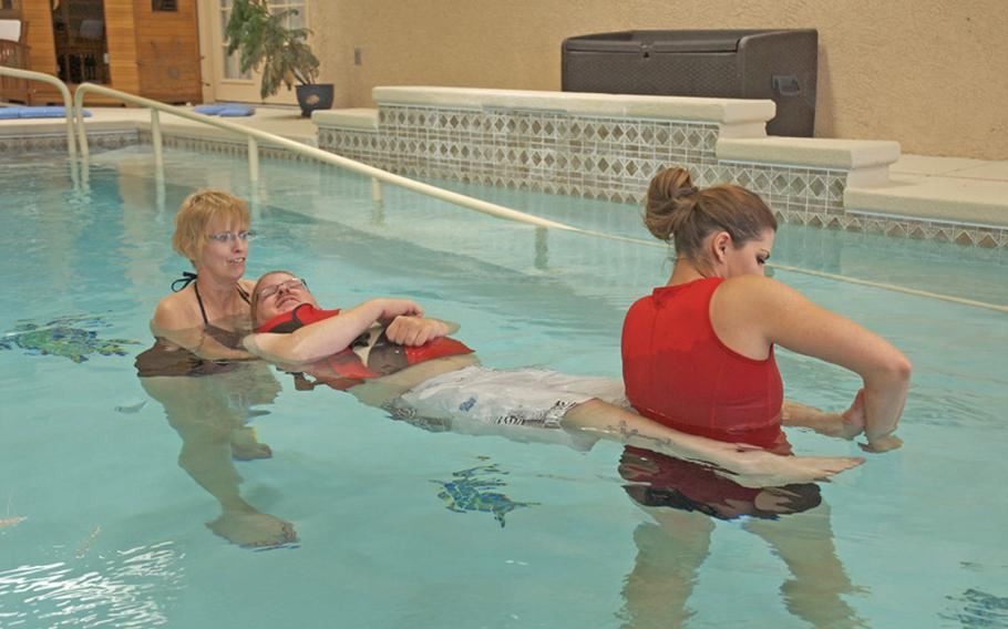 Erik does pool therapy with his mom and an occupational therapy student. The VA paid to have the pool installed in his house, but it's been difficult to find and keep a trainer who specializes in aquatic therapy.