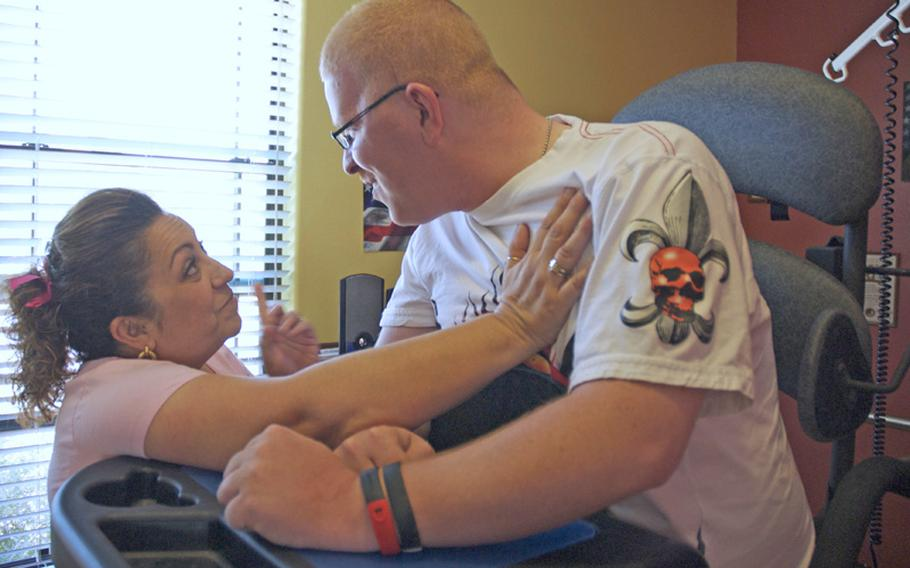 A occupational therapist in training, Kathy Tonnaka, calls Erik out for trying to cheat during a workout that retrains his muscles to stand. The two tease and laugh with each other during their daily sessions at Erik's home.
