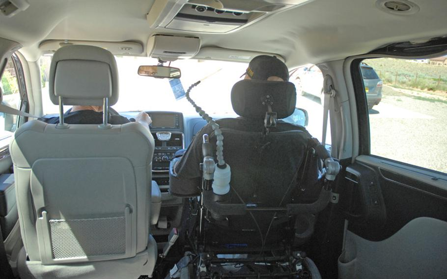 In their special van, Erik sits up front next to his mom, Christine, listening to rap music as they drive to the grocery store in June. Going shopping is Erik's favorite activity, particularly to Costco or Best Buy.