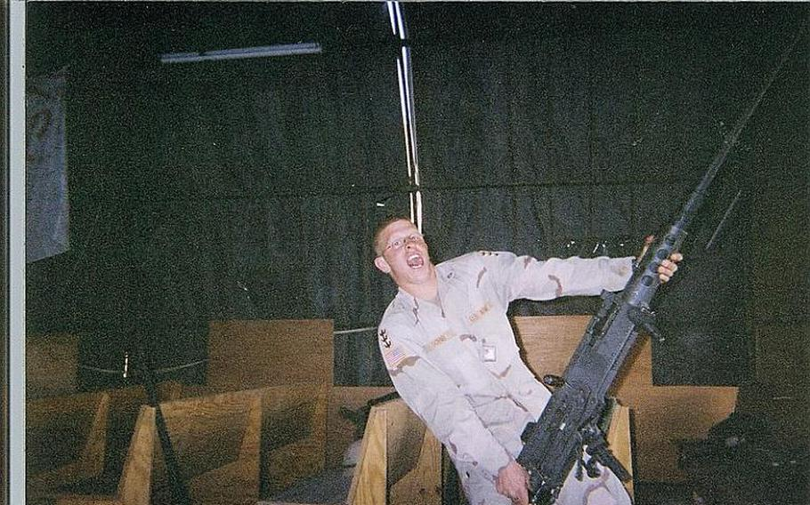Erik Schei poses with the gun he called ''Big Baby Jesus'' while in Iraq.