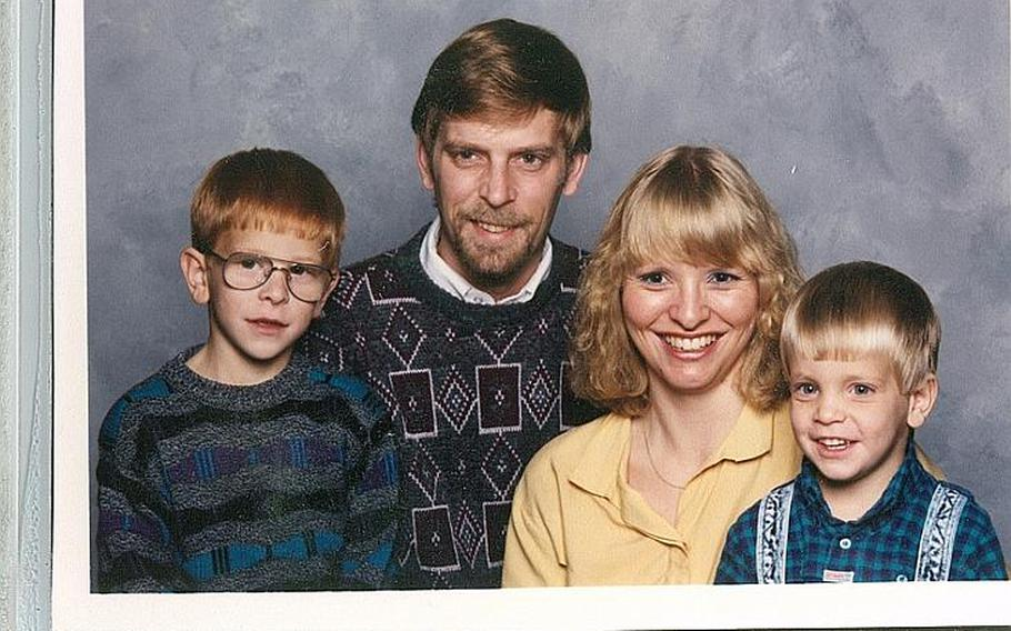 Erik Schei, right, and his little brother, Deven Schei, with their parents Gordon and Christine Schei, in the early 1990s.