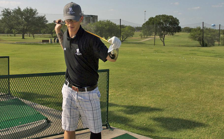Spc. Deven Schei warms up in June before hitting a bucket of balls at the Ft. Sam Houston golf course. After being injured, golf became an outlet for stress relief as he recovered at Brooke Army Medical Center nearby.