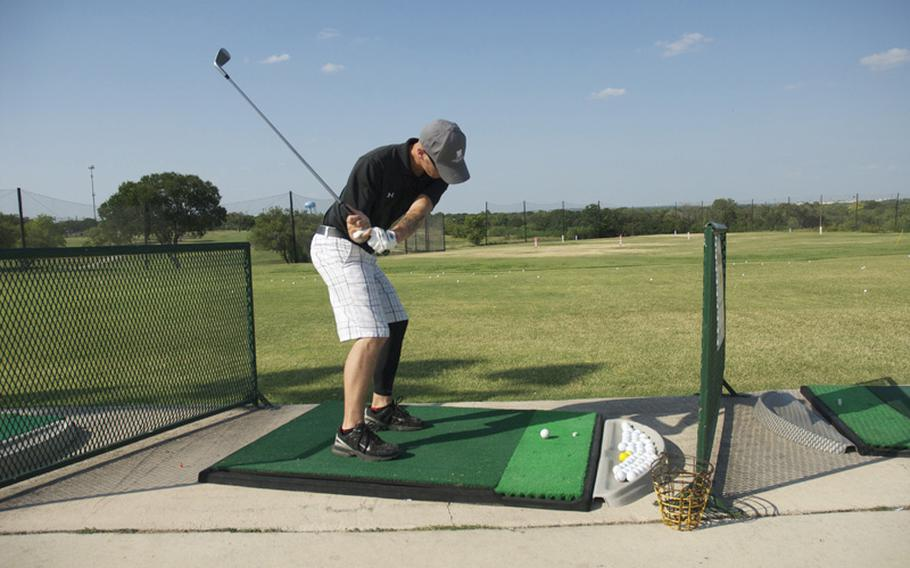 Spc. Deven Schei hits a bucket of balls at the Ft. Sam Houston golf course. After being injured, golf became an outlet for stress relief as he recovered at Brooke Army Medical Center nearby.