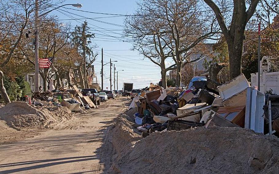 Sand, debris and junked household goods line the streets of neighborhoods in the Rockaways in New York on Nov. 4.