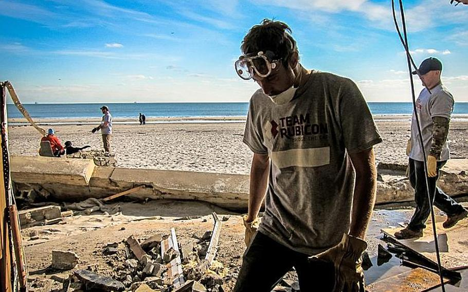 Volunteers with Team Rubicon sort through the rubble of a New York beachfront home destroyed by Superstorm Sandy last month. Officials with the disaster relief group said many homes remain inaccessible in the area, because of the extensive storm damage.