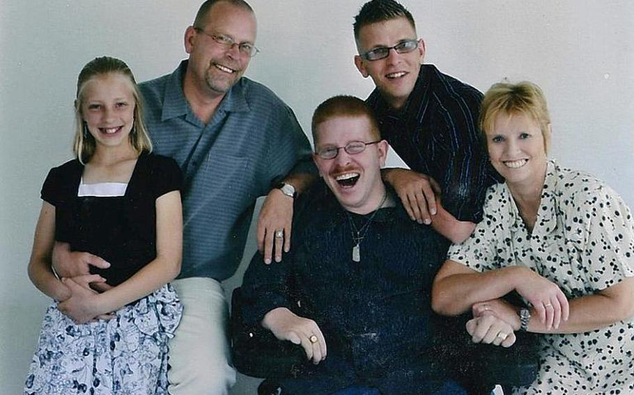 Before Deven Schei deployed to Afghanistan in 2010, his family posed for a portrait. From left: Anneka, Gordon, Erik, Deven and Christine Schei.