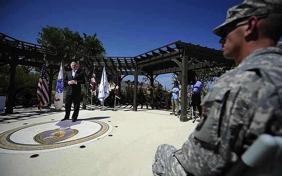 Deputy Secretary of Defense William J. Lynn III delivers remarks before presenting a Purple Heart to U.S. Army Spc. Deven Schei, right, during a ceremony at the Warrior and Family Support Center at Brooke Army Medical Center in San Antonio, Texas, Sept. 28, 2011.