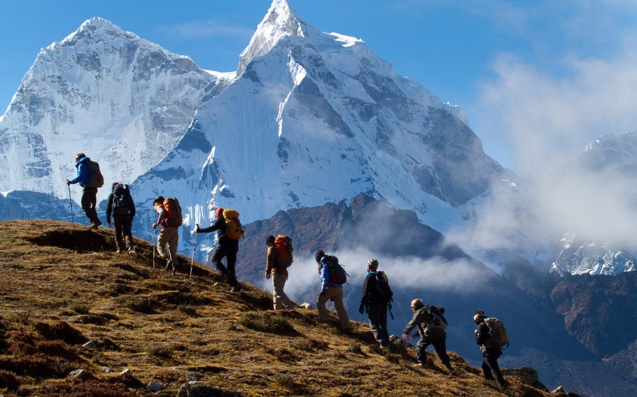 A group of wounded vets makes the climb up the 20,100-foot Lobuche Peak in Nepal. The expedition launched a new program, Soldiers to Summits, which aims to empower vets who suffered severe injuries, such as amputations.