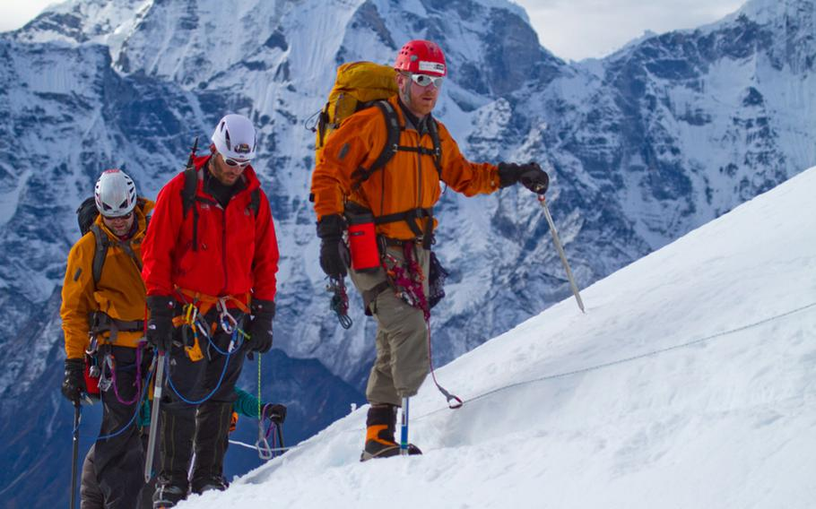 Chad Butrick, Ike Isaacson, Matt Murray, right to left, three-fourths of the the way up Lobuche Peak in Nepal at about 18,000 feet. The 2010 expedition by a group of wounded vets launched a new program, Soldiers to Summits, which aims to empower vets who suffered severe injuries, such as amputations.