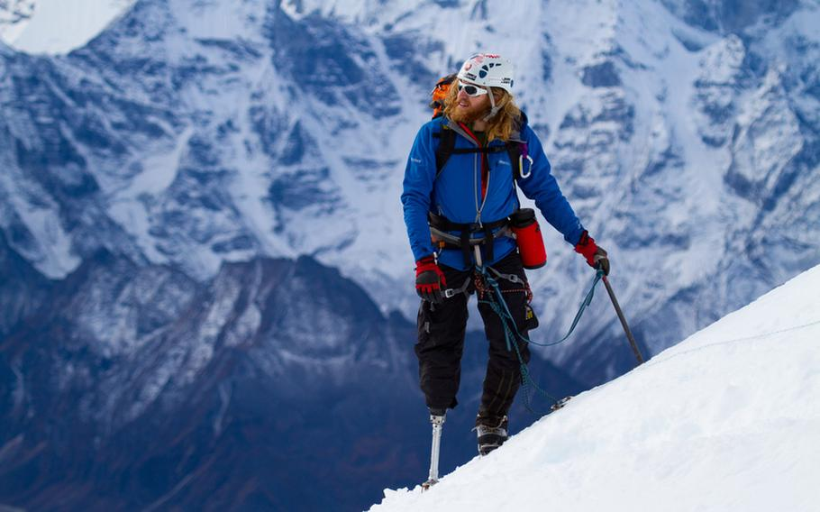 Chad Jukes, a wounded veteran, approaches the summit of a mountain peak high in the Himalayas. The 2010 ascent up the Lobuche Peak is the subject of a new documentary film and also served as the inspiration for a new program that uses mountain climbing as a way to help veterans overcome the scars of war.
