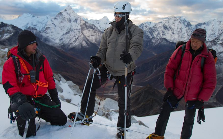 """Steve Baskis, who lost his sight to a roadside bomb blast in Iraq in 2008, works his way up to the top of a mountain peak in the Himalayas. That climb in 2010 is the subject of the new documentary film """"High Ground,"""" which features wounded veterans.  The climb also launched a new program called Soldiers to Summits."""
