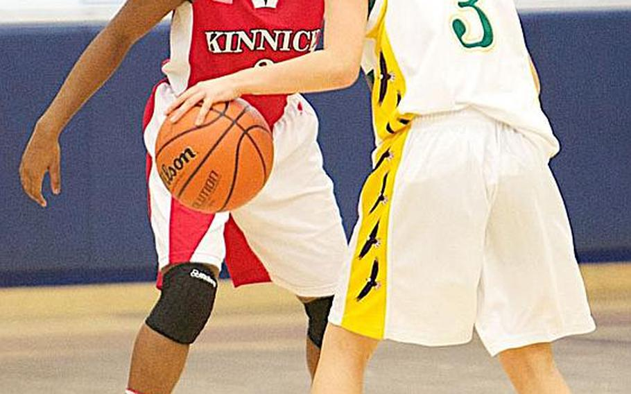 Point-counterpoint. De'Asia Brown of Nile C. Kinnick Red keeps a wary eye on Vanessa Black of Robert D. Edgren during Friday's DODDS Japan season-opening high school basketball game at Misawa Air Base, Japan. Kinnick doubled up Edgren 46-23.