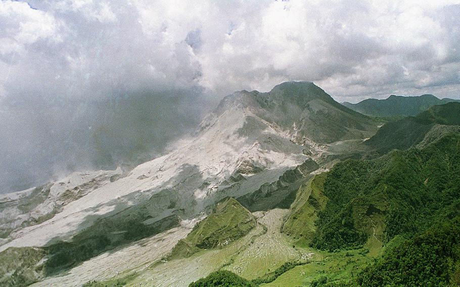 A huge area of ash flow dominates what used to be the green mountain ranges near Mount Pinatubo following a major eruption in this June 12, 1991, file photo. Geologists plan to hack a notch into Mount Pinatubo's crater in a dangerous operation to drain a volcano lake that threatens nearby villages with mass floods, scientists said Thursday, Aug. 16, 2001.