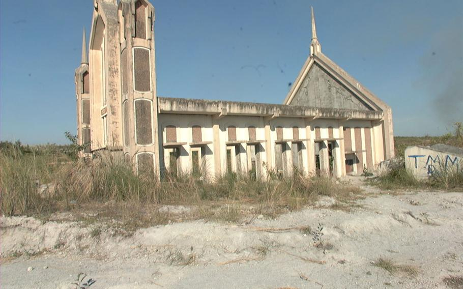 The top half of a destroyed church rises above the ashes from Mt. Pinatubo just outside Clark Air Base