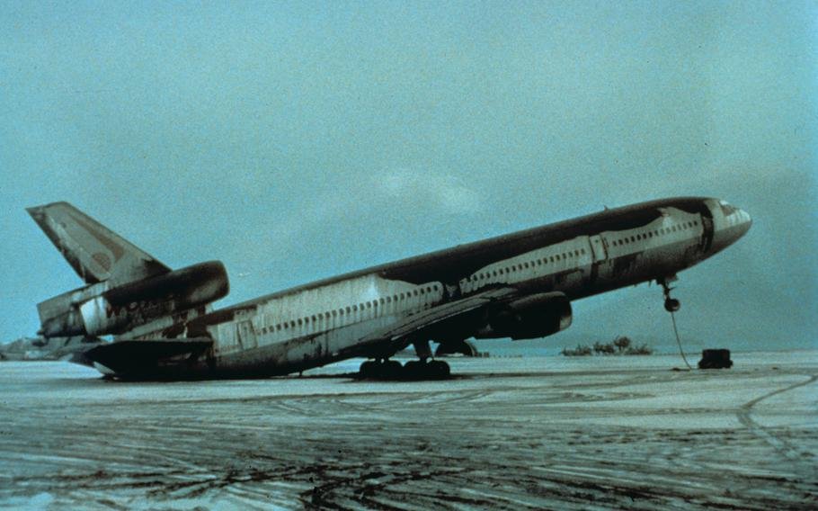 Mount Pinatubo, Philippines. View of World Airways DC-10 airplane setting on its tail because of weight of June 15, 1991 ash. Cubi Point Naval Air Station.