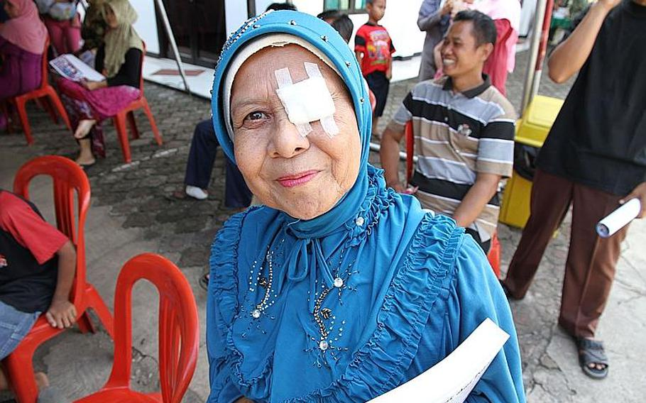 An Indonesia woman leaves the free medical clinic held during the Garuda Shield exercise after being treated for an eye infection.