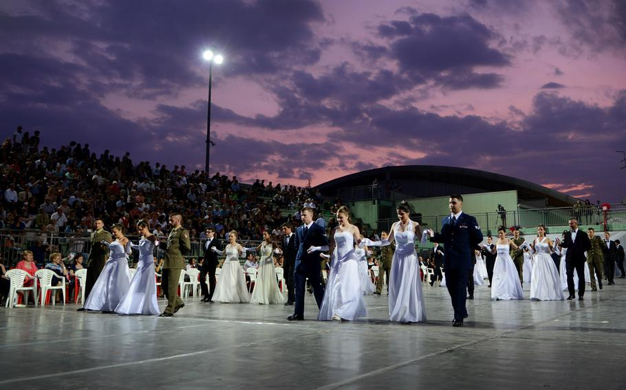 Participants present themselves during the 15th edition of Ballo delle Debuttanti June 30, 2013, in Cordenons, Italy. The ball hosted 38 debutants that were accompanied by members from the 31st Fighter Wing, the the Italian army and other local Italians. The dance is a tradition dating back to the 1800s that introduces women into society when they are considered mature enough, typically by 17 to 18 years of age.