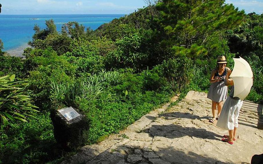 Visitors take in the ocean view at Sefa Utaki, a United Nations heritage site and the holiest location on Okinawa.