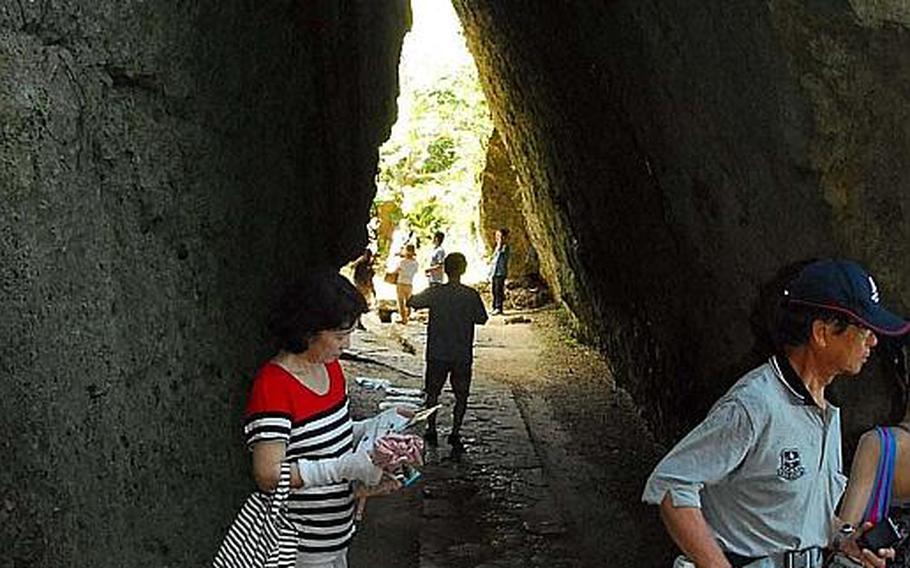 Sefa Utaki's distinctive natural tunnel leads to the holiest altar on Okinawa.