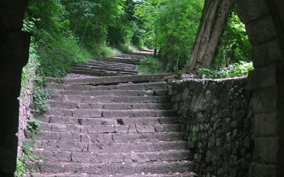 The path up to the Santuario di Santa Augusta consists of a series of stairways and cobblestone walkways - mostly covered by trees.