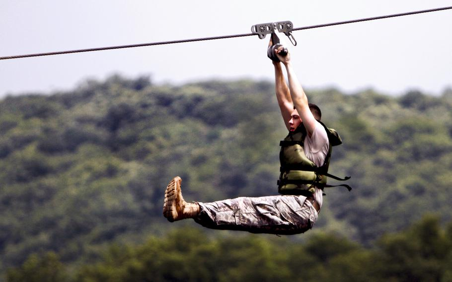 An Army cadet slides along a rope over a water obstacle during a training exercise at Camp Buckner at the U.S. Military Academy at West Point, N.Y. Cadet teams participated in such exercises as marksmanship, urban operations and land navigation. The exercises trained more than 1,000 cadet candidates from the Class of 2016.