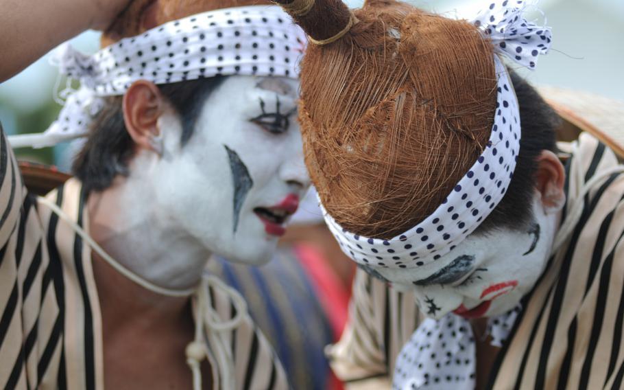 Eisa performers wear elaborate traditional costumes at the 58th Okinawa Zento Eisa Matsuri contest in Okinawa City, Okinawa, Sept. 1, 2013.