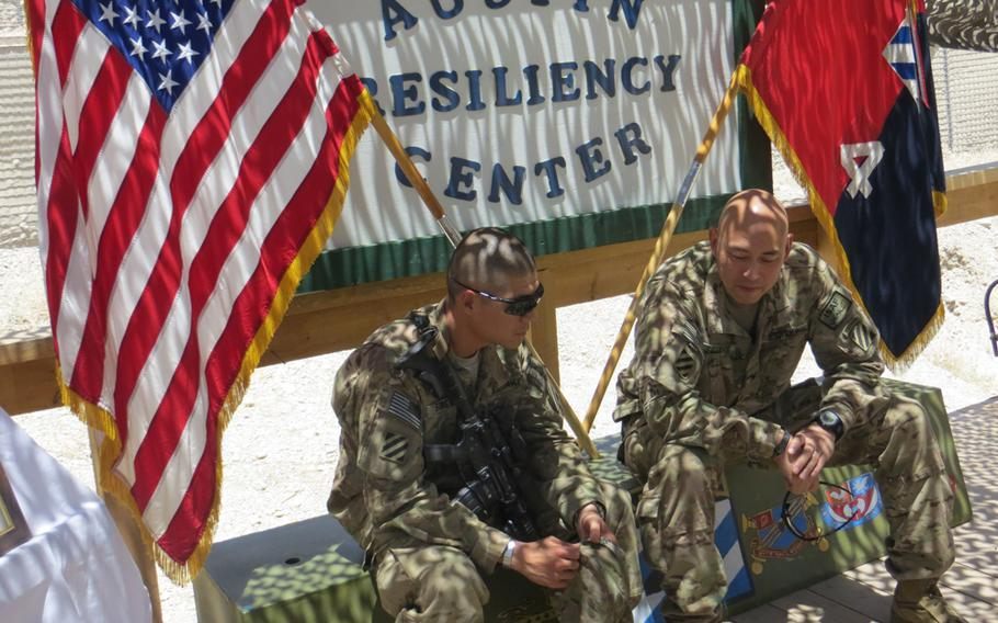 Capt. Philip Song, left, and Col. Kimo Gallahue with the 4th Brigade Combat Team, 3rd Infantry Division talk after the dedication of the Austin Resiliency Center at Forward Operating Base Shank in eastern Afghanistan. The center is named for Pfc. Barrett Austin, who died in April from injuries he suffered when a roadside bomb exploded beneath the armored truck he was driving.