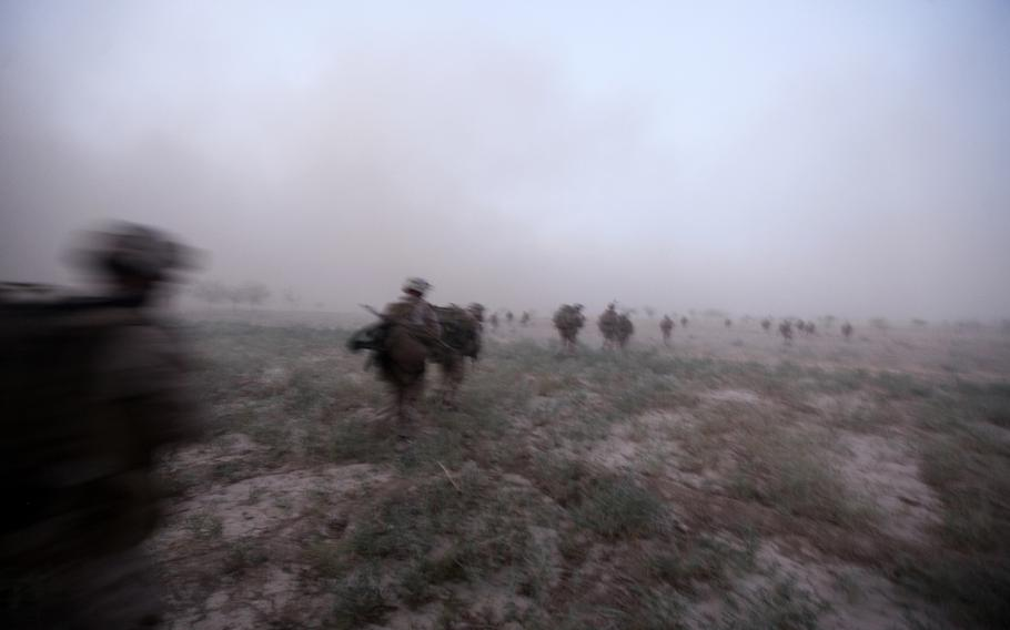 British soldiers and U.S. Marines with Company G, 2nd Battalion, 8th Marines, Afghan Territorial Force 444 head out for a mission in Helmand province, Afghanistan, Aug. 31, 2013.
