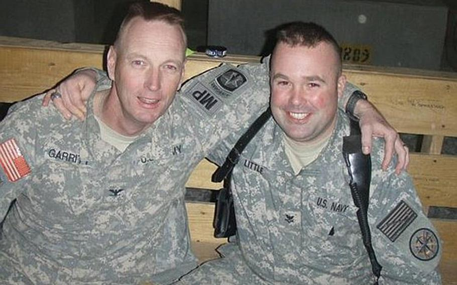 Mike Little poses with a commanding officer during his deployment in Iraq in 2008.