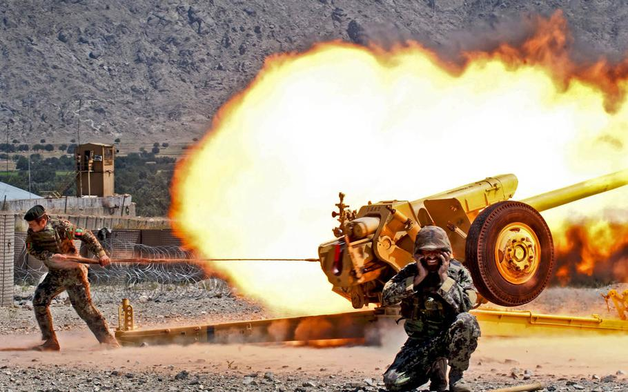 An Afghan army fire support crew fires a D-30 122mm howitzer during certification exercises on Forward Operating Base Tagab in Kapisa province, Afghanistan, Sept. 5, 2013.