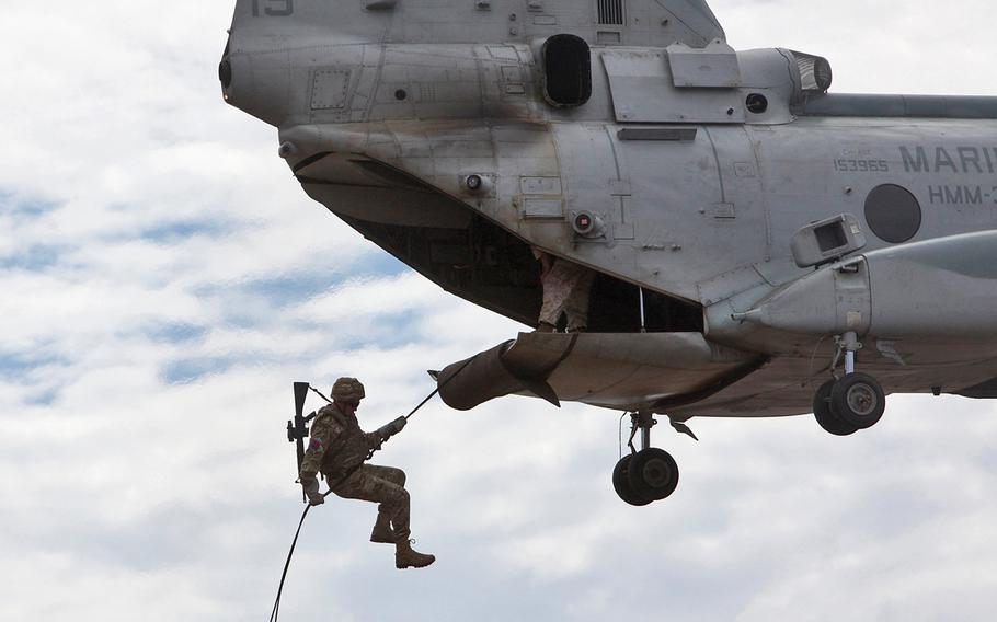 A British army commando with the 148th Battery, 29th Commando Fire Support Team, Royal Artillery, rappels from a CH-46 Sea Knight during Exercise Burmese Chase 2013, at Camp Pendleton, Calif., Sept. 6, 2013.