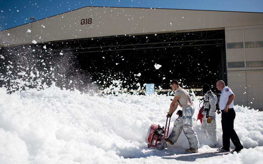A small sea of fire retardant foam was unintentionally released in an aircraft hangar, temporarily covering a small portion of the flight line at Travis AFB, Calif., Sept. 24, 2013. The non-hazardous foam is similar to dish soap, and eventually dissolved into liquid, which was helped by high winds. The 60th Air Mobility Wing firefighters helped control the dispersion by using powerful fans and covering drains.
